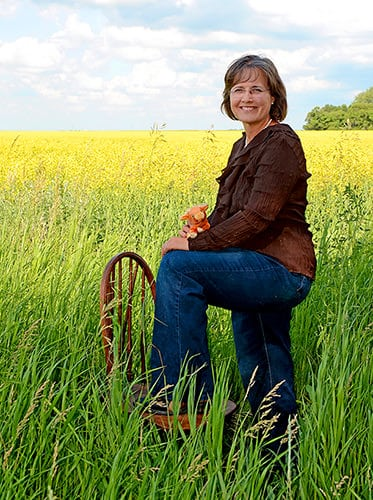 Elaine-Froese-in-field-chair-vertical-medium